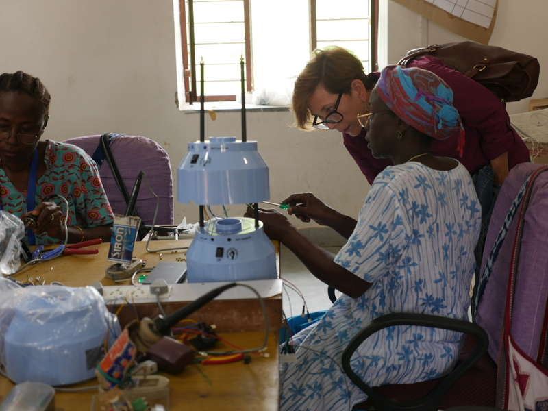 Expedition Team Member, Renae Wilson, learns about assembling solar lanterns from women at Barefoot College